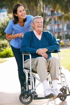 a caregiver and her patient in a wheelchair