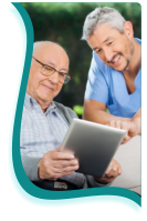 A caregiver and a patient uses the gadget