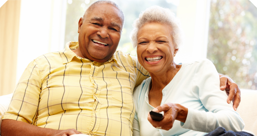 A happy elderly couple smiling