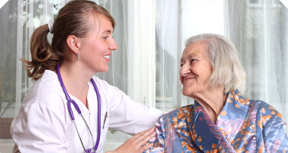 Smiling elderly with her nurse